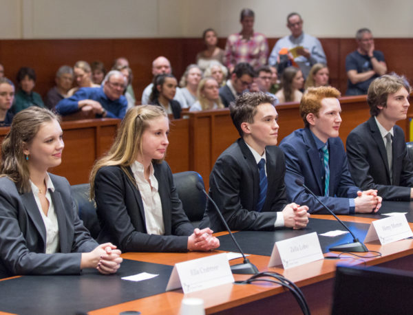 A high school Mock Trial team performs in the courtroom.