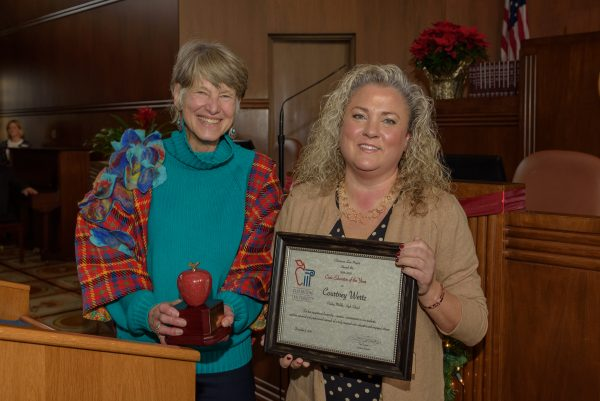 Oregon Supreme Court Justice Martha Walters presents Courtney Wertz as Oregon's Civic Educator of the Year.